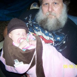 Here I am.....holding my Granddaughter at our camp